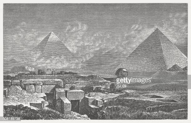 giza, pyramides and sphinx, wood engraving, published in 1882 - mycenae stock illustrations