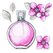 glass bottle with pink female perfume