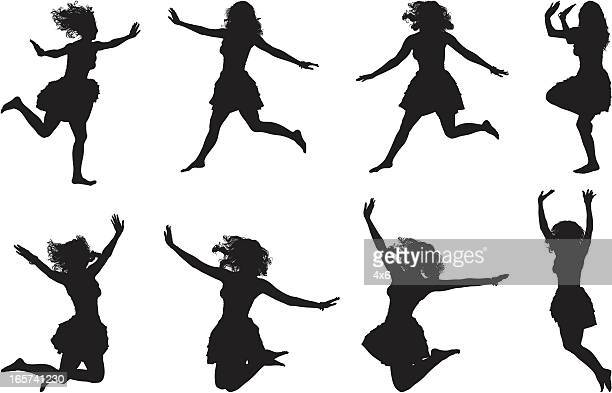 Gleeful woman in dress jumping