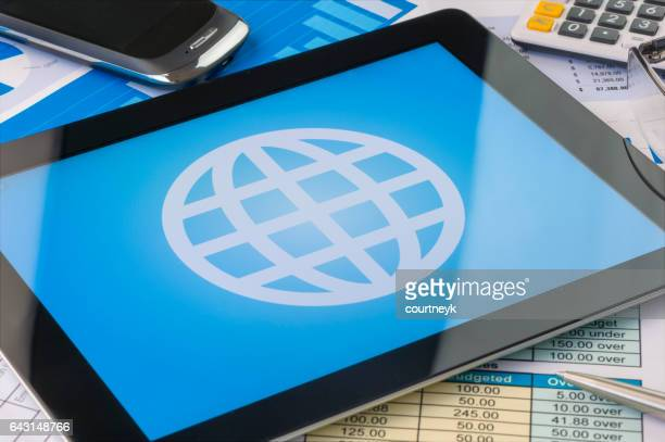 globe icon on a digital tablet - touch sensitive stock illustrations