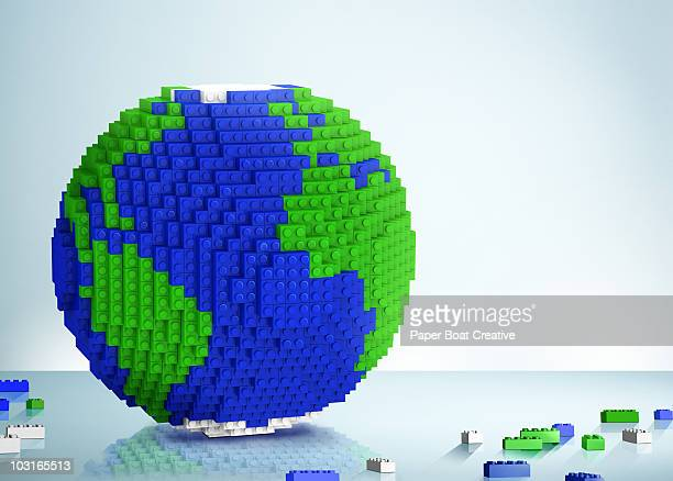 3d globe made of toy building blocks - digital composite stock illustrations, clip art, cartoons, & icons