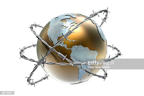 globe shows America wrapped with barbwire