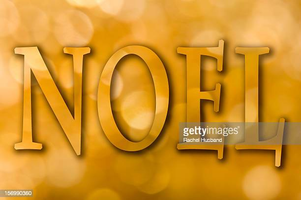 Gold bokeh background with the word 'Noel'