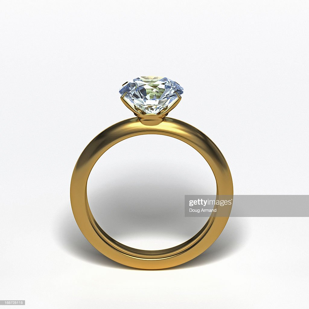 Gold diamond ring upright on white surface : ストックイラストレーション