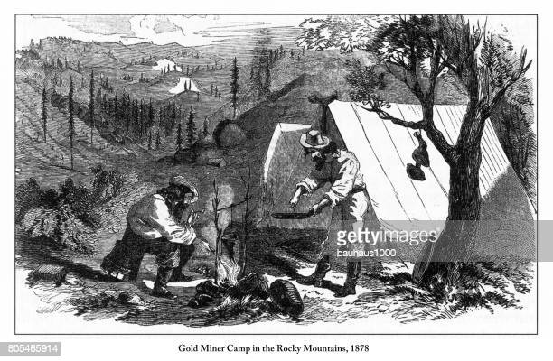 gold miner camp in the rocky mountains victorian engraving, 1878 - gold rush stock illustrations