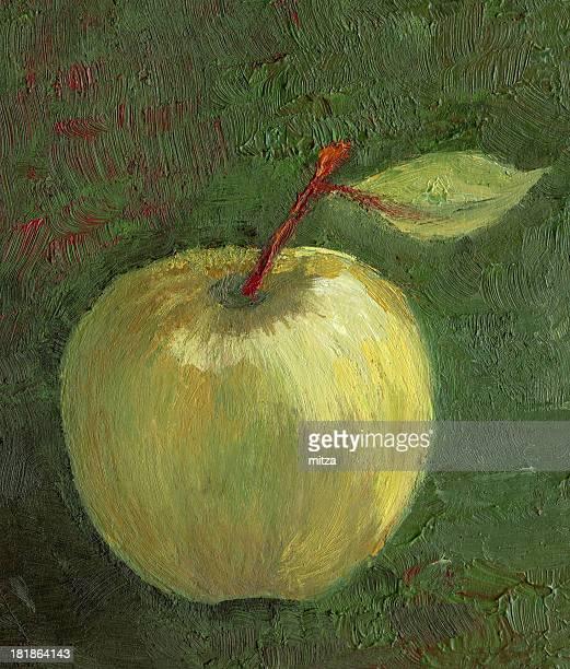 Golden apple on textured dark green background