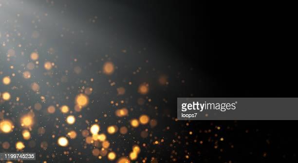 golden defocused lights background with copy space - defocused stock illustrations
