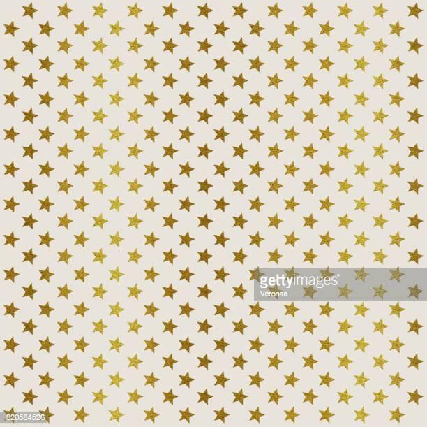 Étoiles d'or sur fond blanc
