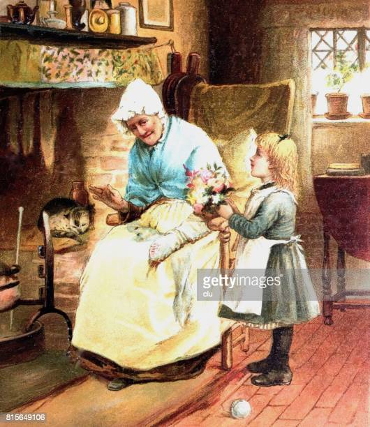 Grandma sitting at the fireplace getting flowers from grand daugther