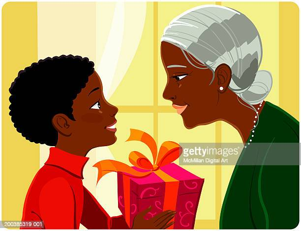 grandmother giving gift to grandson (8-10), side view - 8 9 years stock illustrations, clip art, cartoons, & icons