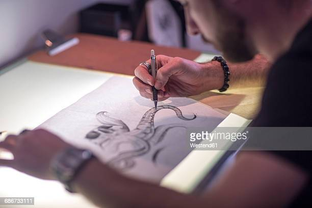 graphic artist sketching - one young man only stock illustrations