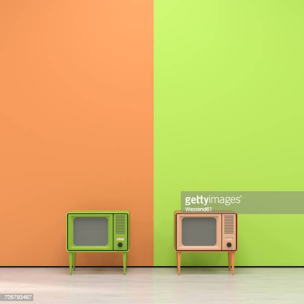 Green and orange television in retro style in front of orange yellow wall