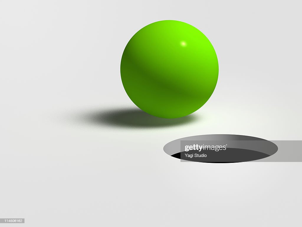 A green ball and hole : Stock Illustration