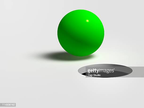 A green ball and hole