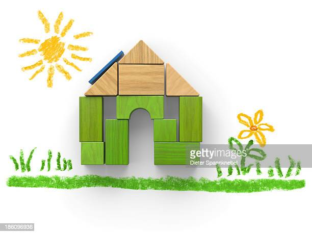 Green house of wooden blocks with drawing
