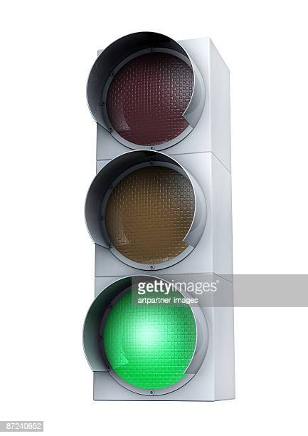 green light on white background - stoplight stock illustrations