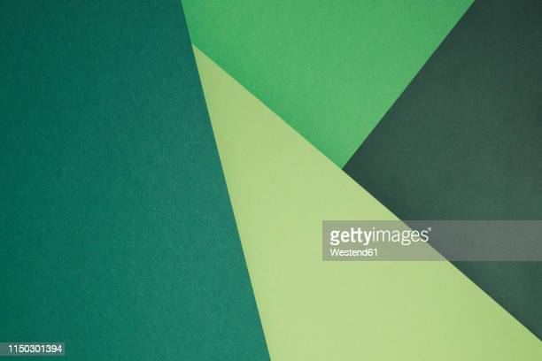 green set of paper as an abstract background - geometrische form stock-grafiken, -clipart, -cartoons und -symbole