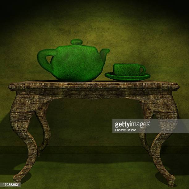 green teapot with a cup on a table - green tea stock illustrations, clip art, cartoons, & icons