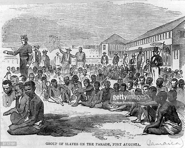 Group of formerly enslaved people on the parade at Fort Augusta, Jamaica, liberated after the ship they were imprisoned in was captured by an English...