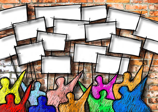 A group of people show many blank placards against a brick wall - concept image