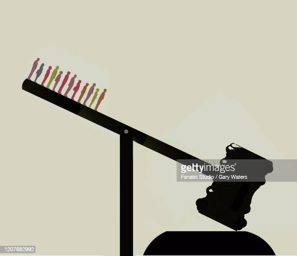 group of people standing on a gavel - unfairness stock illustrations