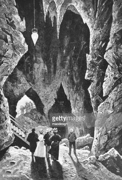 group of people visit the rock cave - 1896 - 1896 stock illustrations, clip art, cartoons, & icons