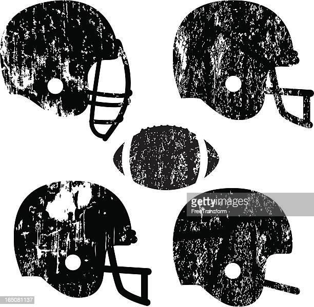 grunge football helmets - football helmet stock illustrations