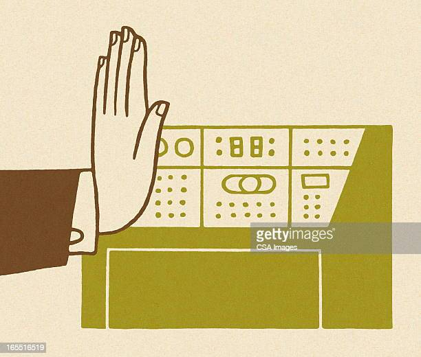 Hand by a Control Panel
