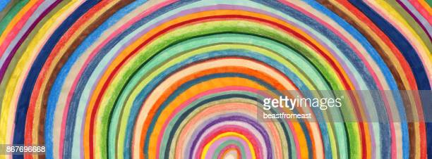hand coloured circular stripes background patter - rainbow stock illustrations, clip art, cartoons, & icons