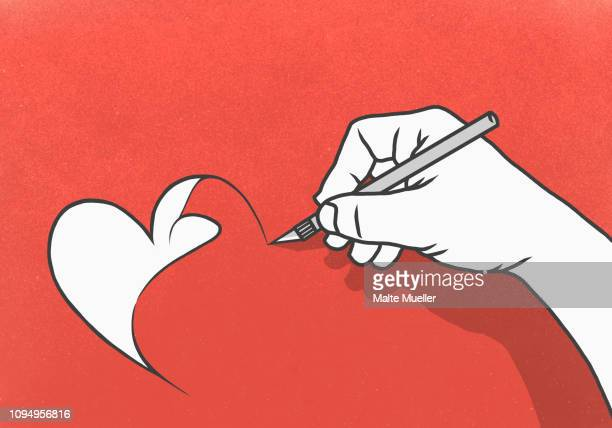 hand cutting heart-shape out of red paper with scalpel - unrecognisable person stock illustrations