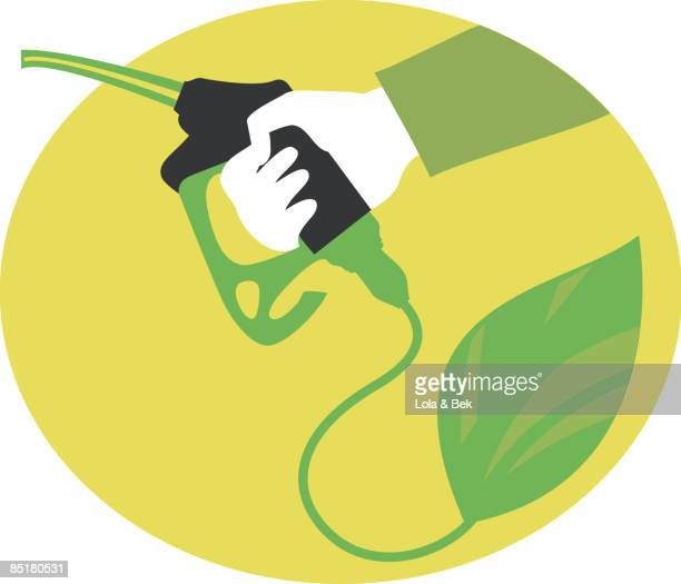 A hand holding a gas pump that is attached to a leaf