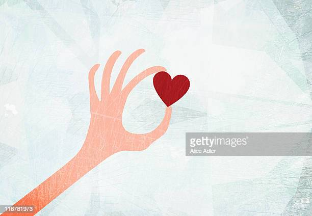 A hand holding a heart
