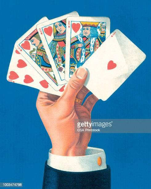 ilustrações, clipart, desenhos animados e ícones de mão segurando um straight flush - poker