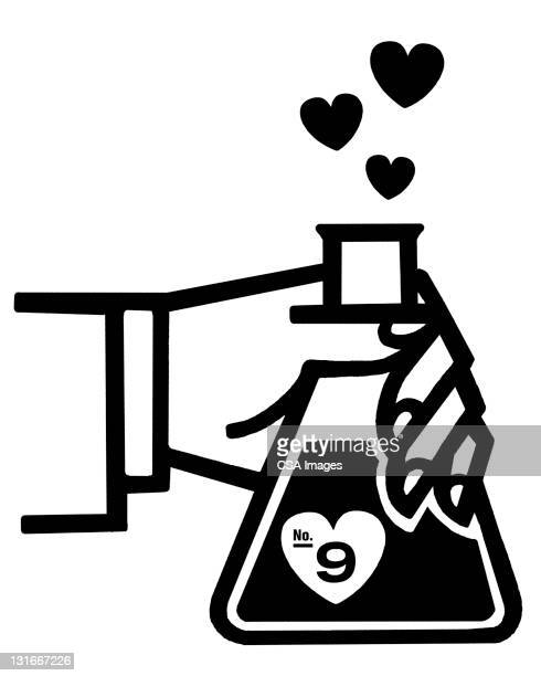 Hand Holding Beaker of Hearts
