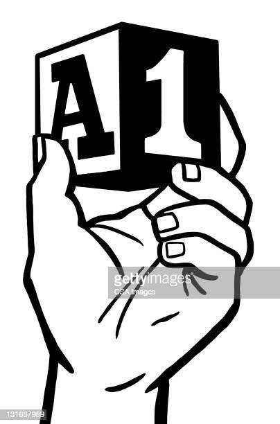 hand holding block - the alphabet stock illustrations
