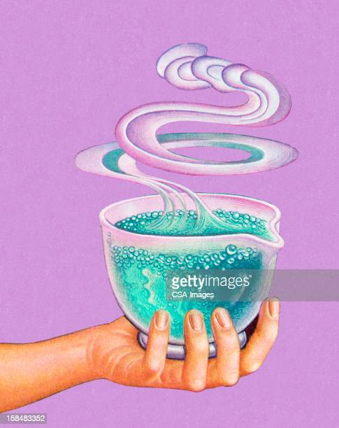 hand holding bubbling potion - potion stock illustrations