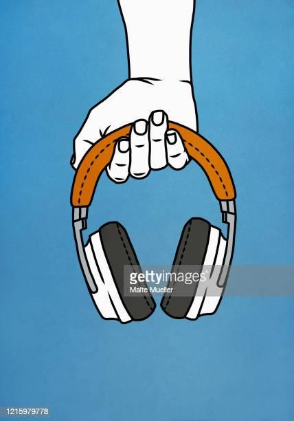 hand holding headphones - vertical stock illustrations