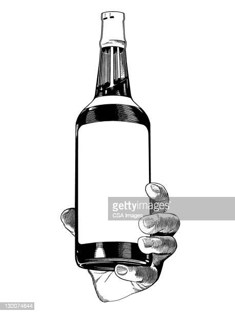 Hand Holding Liquor bottle