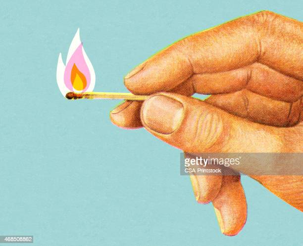Hand Holding Lit Match