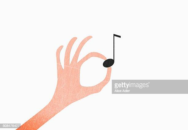 illustrations, cliparts, dessins animés et icônes de hand holding musical note against white background - note de musique