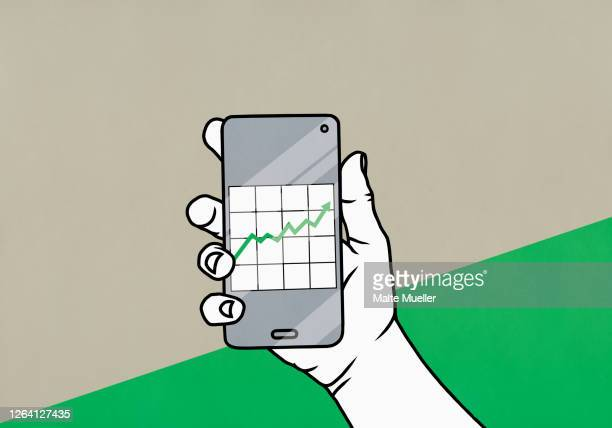pov hand holding smart phone with data graph - börsenhandel finanzberuf stock-grafiken, -clipart, -cartoons und -symbole
