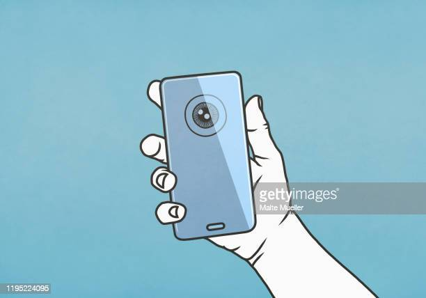 hand holding smart phone with retina scan - eye scanner stock illustrations