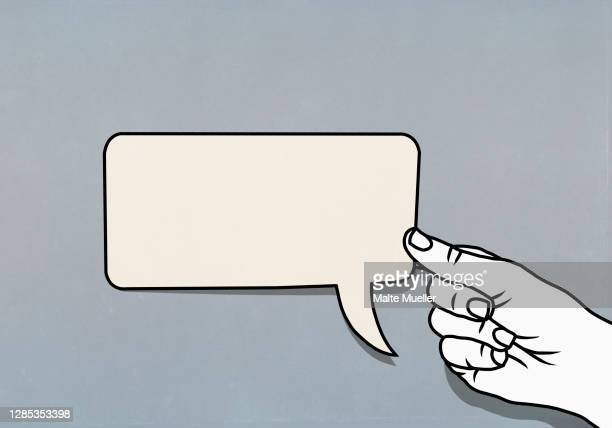 hand holding speech bubble adhesive note - people stock illustrations