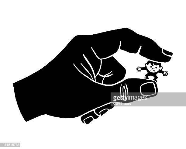 Hand Holding Tiny Man
