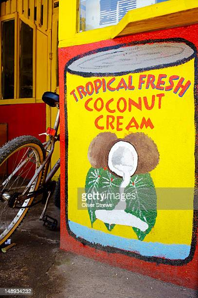 hand painted advertisement for coconut cream. - pacific islands stock illustrations