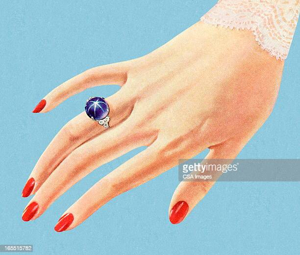 Hand Showing Off a Pretty Blue Ring