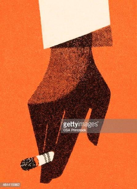 ilustraciones, imágenes clip art, dibujos animados e iconos de stock de mano con cigarrillo - cigarrillo