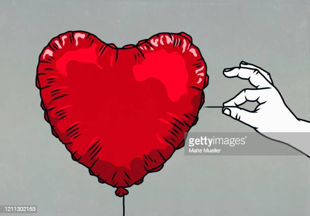 hand with pin ready to pop red heart shape balloon - unrecognisable person stock illustrations