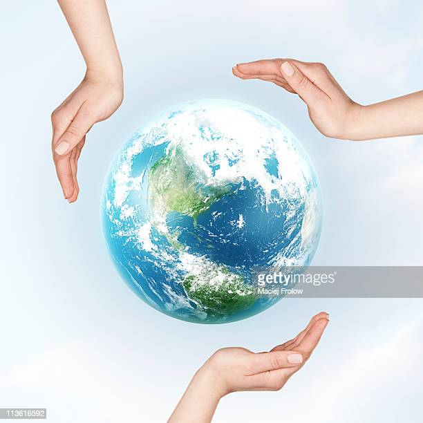 hands all over earth planet - protection stock illustrations