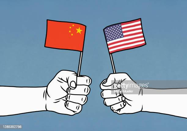 hands clenching chinese and american flags on blue background - american culture stock illustrations